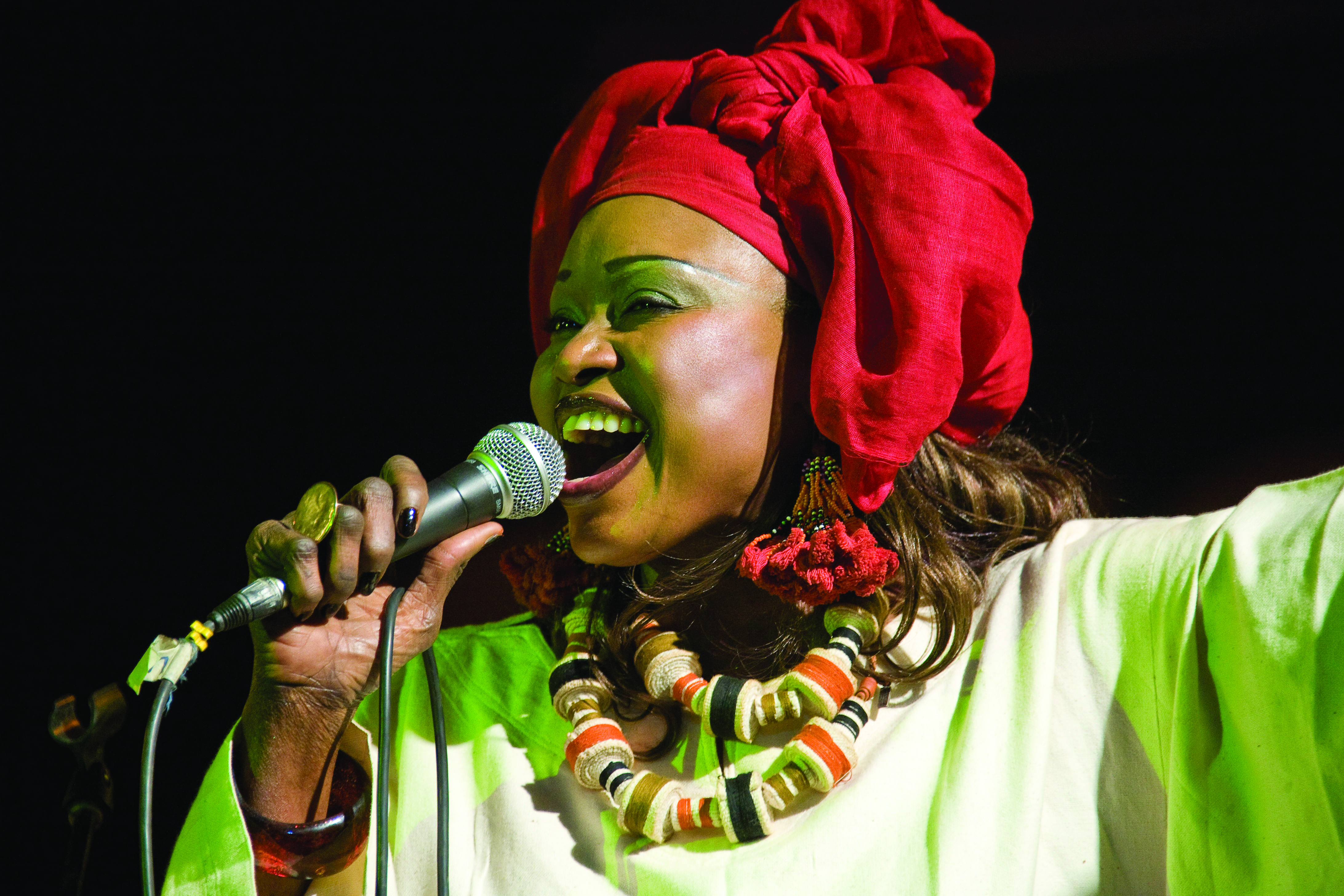 Oumou Sangare Alioune Ba onstage singing close up